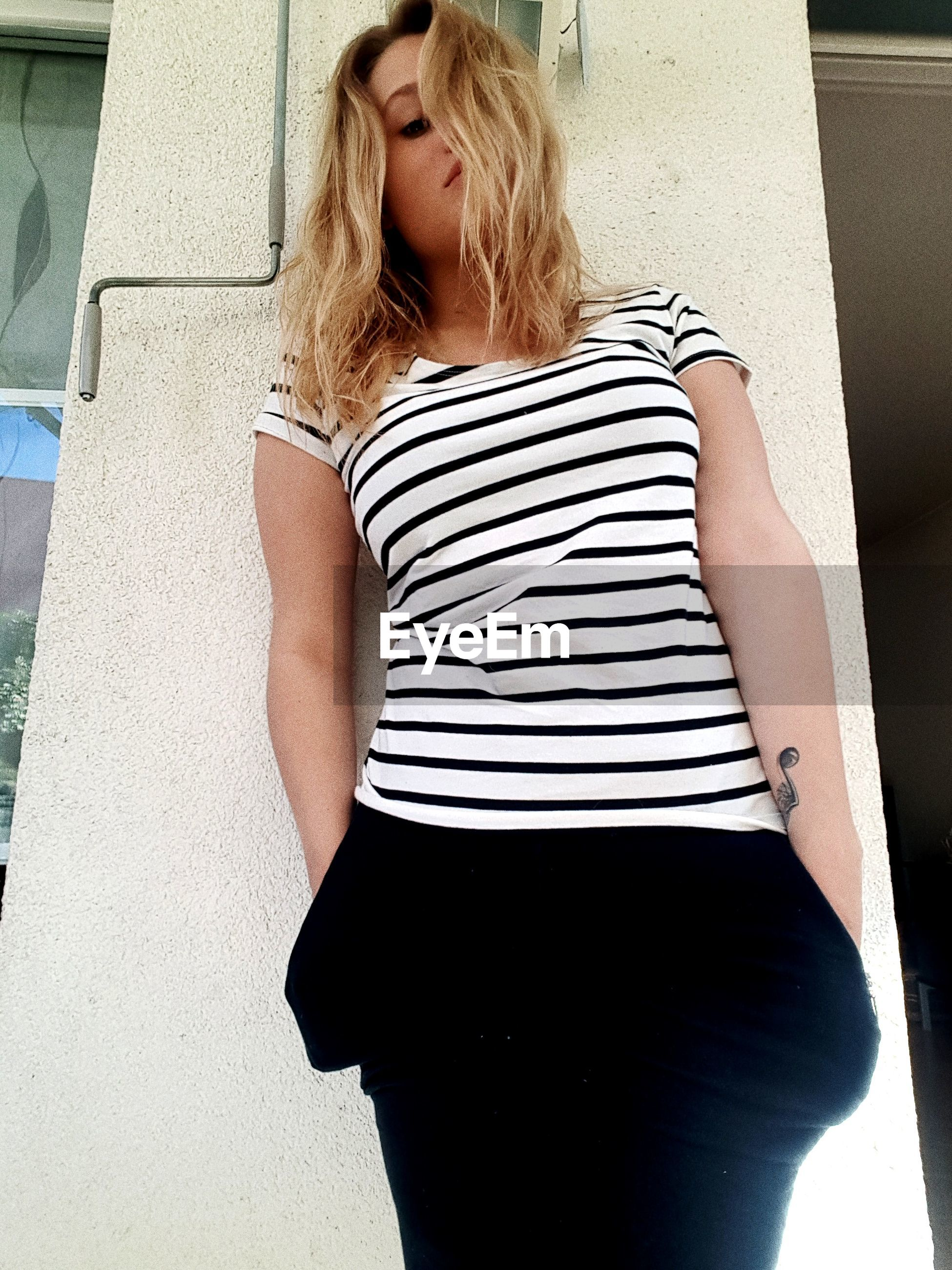 striped, blond hair, only women, one woman only, one person, waist up, pregnant, adults only, front view, women, beauty, beautiful woman, indoors, young women, real people, day, adult, people, human abdomen, human body part, abdomen