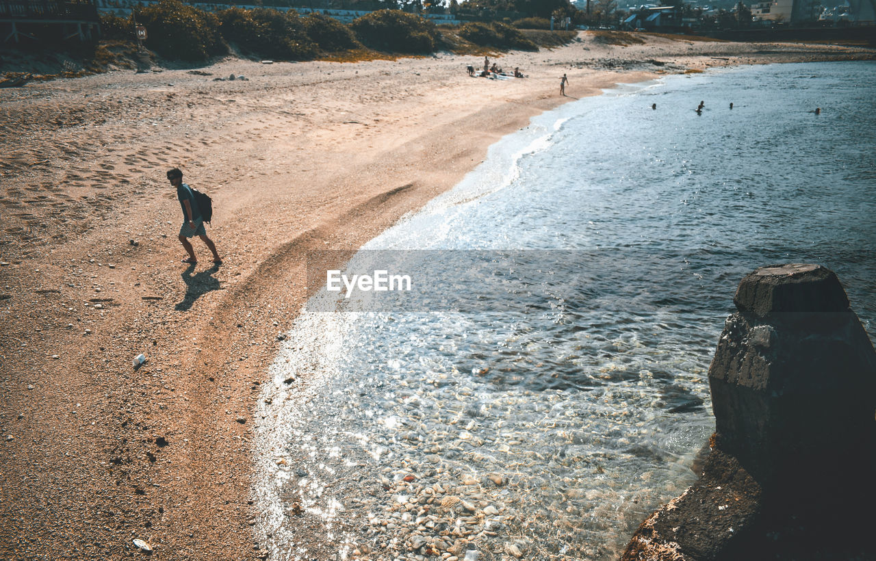 water, rock, full length, motion, land, one person, real people, day, nature, leisure activity, lifestyles, men, solid, rock - object, sea, holiday, beauty in nature, beach, outdoors