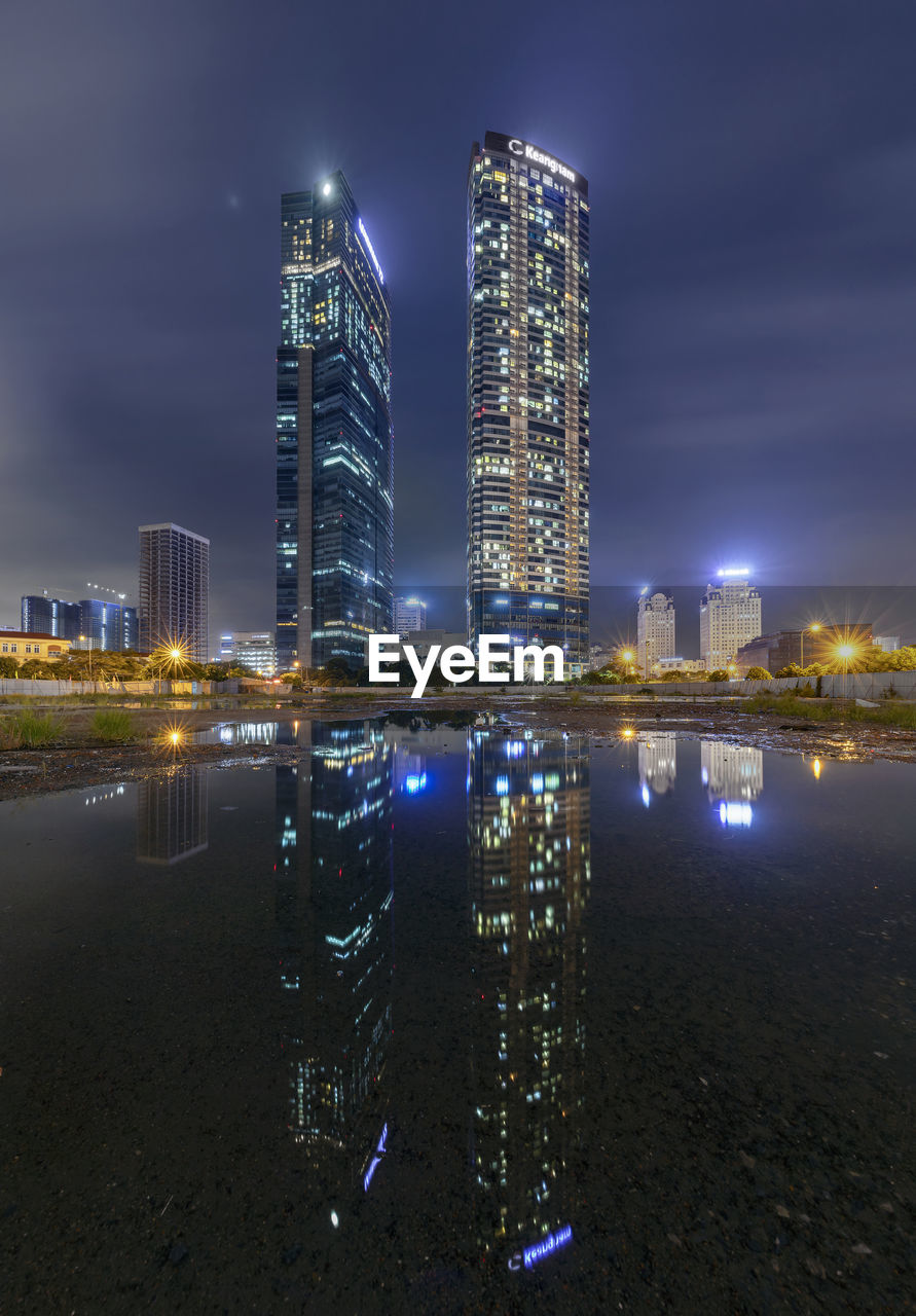 building exterior, built structure, architecture, night, illuminated, city, building, sky, office building exterior, water, skyscraper, tall - high, modern, nature, cityscape, landscape, tower, urban skyline, office, no people, outdoors, financial district, nightlife, bay