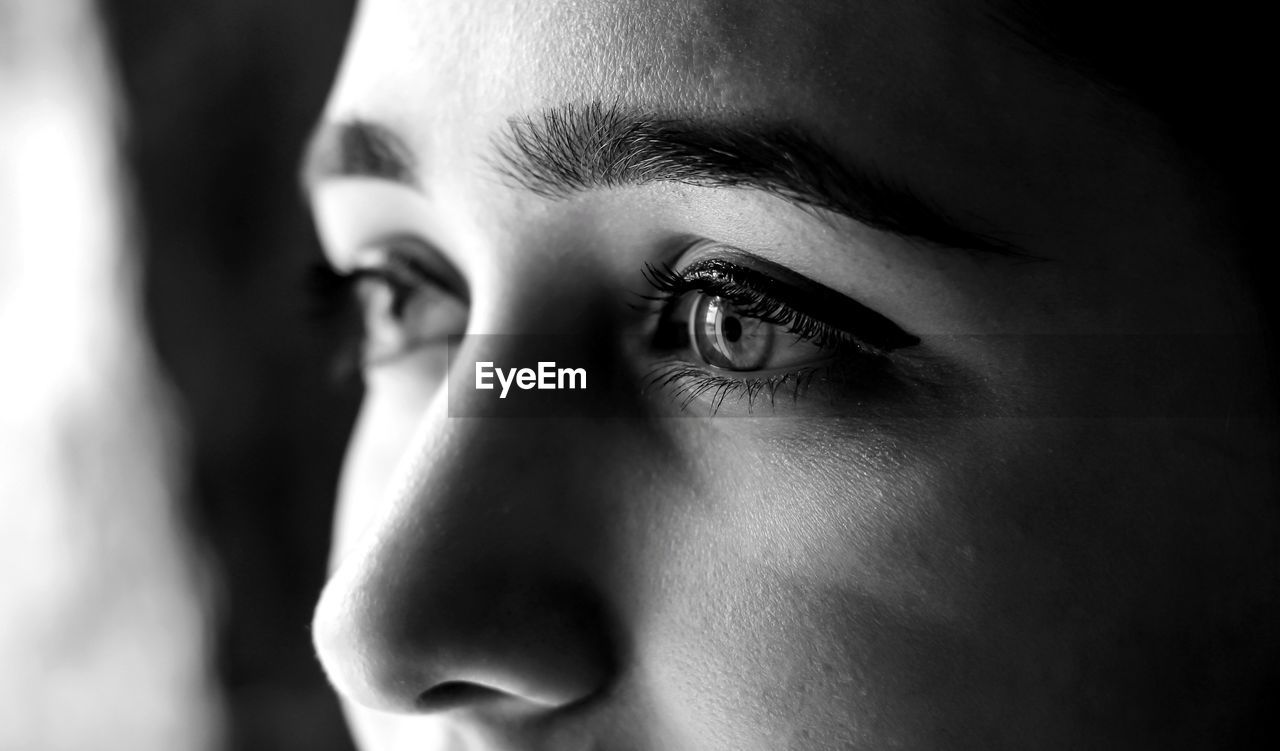 human body part, close-up, one person, young adult, human eye, human face, portrait, body part, indoors, headshot, eye, real people, looking, looking away, lifestyles, focus on foreground, young men, men, eyebrow, contemplation, eyeball, teenager
