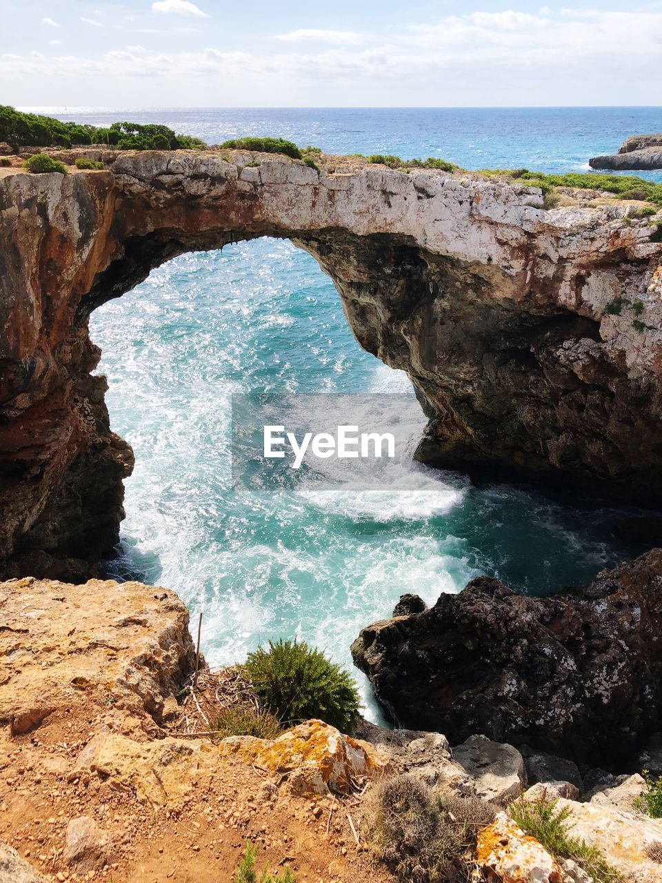 sea, water, rock, rock - object, solid, beauty in nature, rock formation, scenics - nature, land, nature, beach, tranquility, sky, no people, day, tranquil scene, horizon, motion, horizon over water, natural arch, outdoors, power in nature, eroded