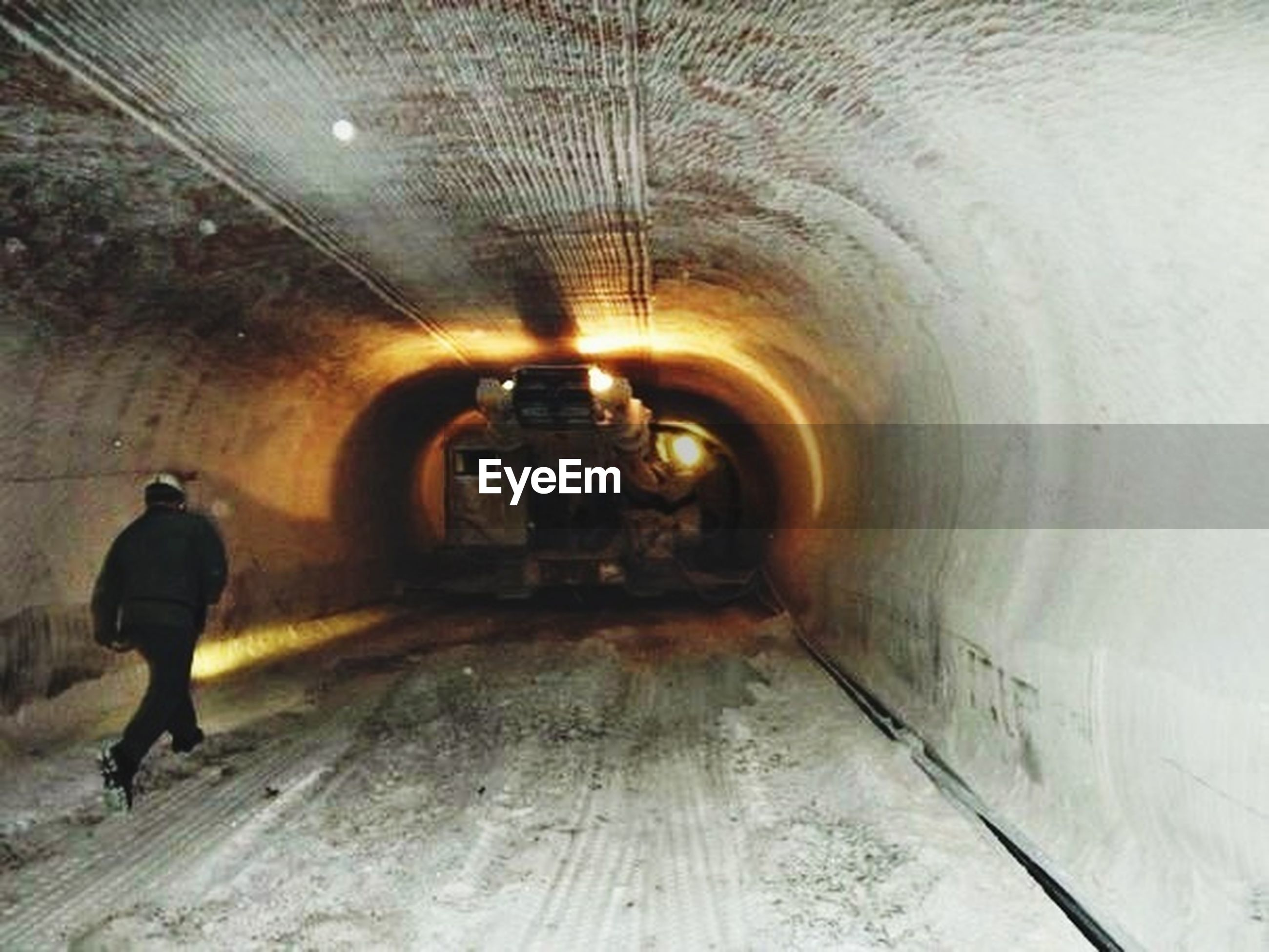 indoors, tunnel, the way forward, lifestyles, full length, walking, men, rear view, arch, ceiling, illuminated, leisure activity, standing, light at the end of the tunnel, architecture, built structure, diminishing perspective, wall - building feature