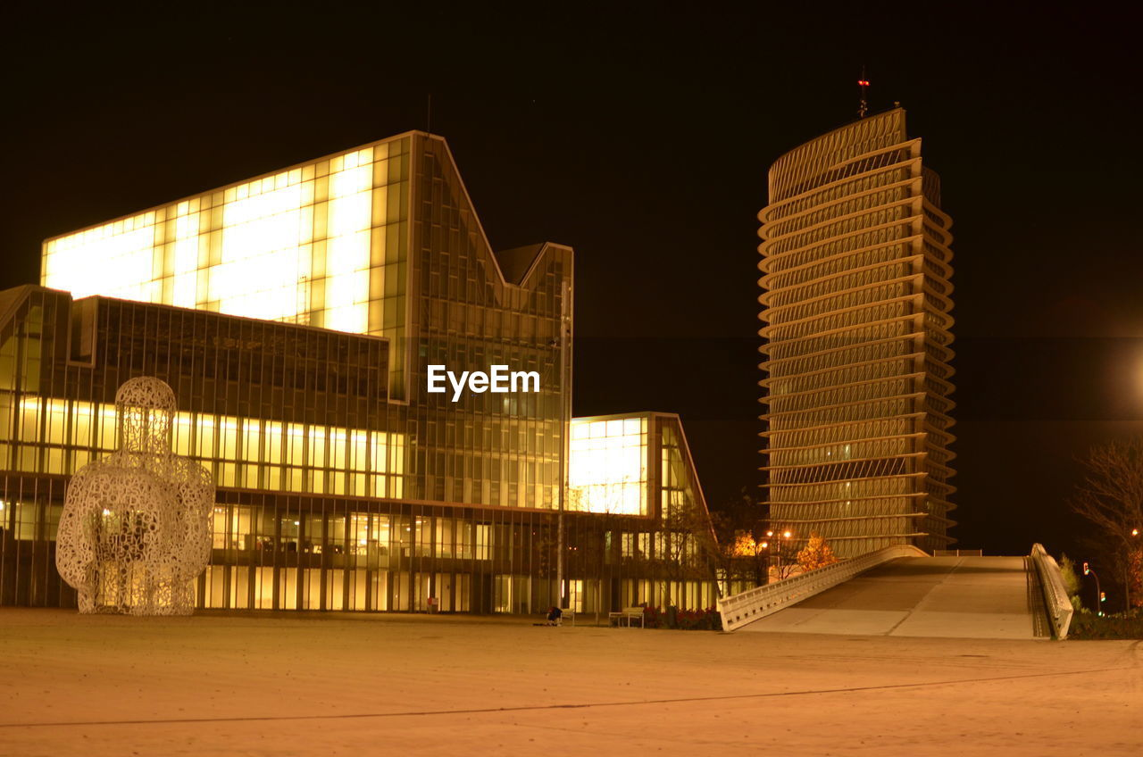 architecture, illuminated, night, built structure, building exterior, city, modern, skyscraper, outdoors, no people, cityscape, sky