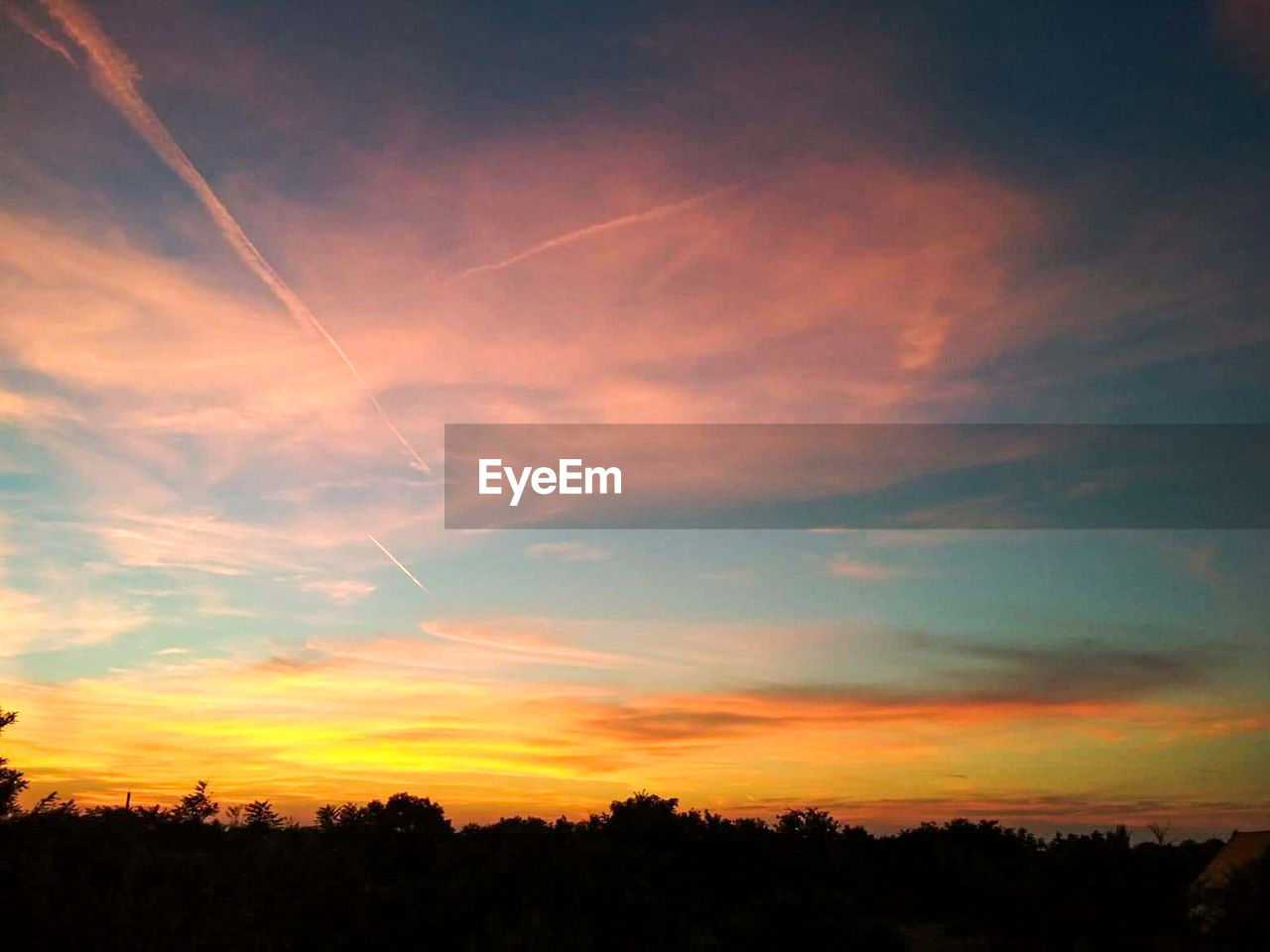 sky, cloud - sky, sunset, beauty in nature, scenics - nature, tranquility, silhouette, tranquil scene, tree, plant, nature, orange color, landscape, no people, idyllic, environment, outdoors, vapor trail, low angle view, non-urban scene, romantic sky