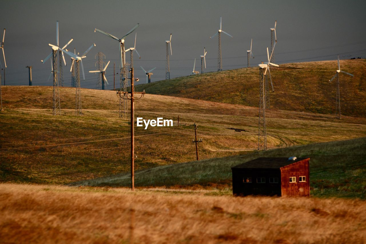 wind turbine, fuel and power generation, environment, landscape, turbine, renewable energy, land, alternative energy, field, environmental conservation, no people, wind power, sky, technology, nature, outdoors, rural scene, day, beauty in nature, boundary, power supply