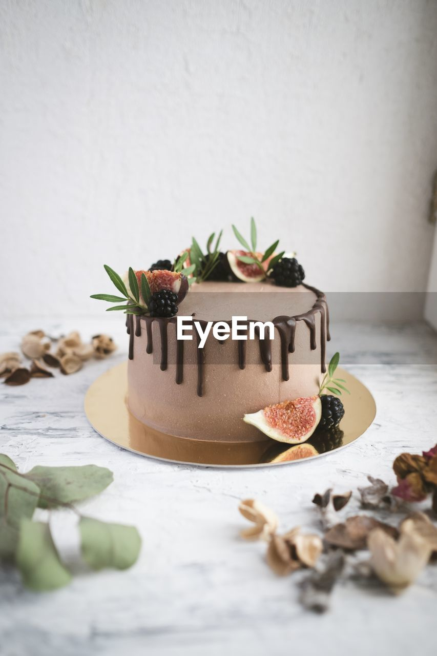 food and drink, food, sweet food, freshness, sweet, indulgence, dessert, indoors, still life, table, no people, temptation, cake, baked, text, celebration, leaf, ready-to-eat, unhealthy eating, western script, garnish