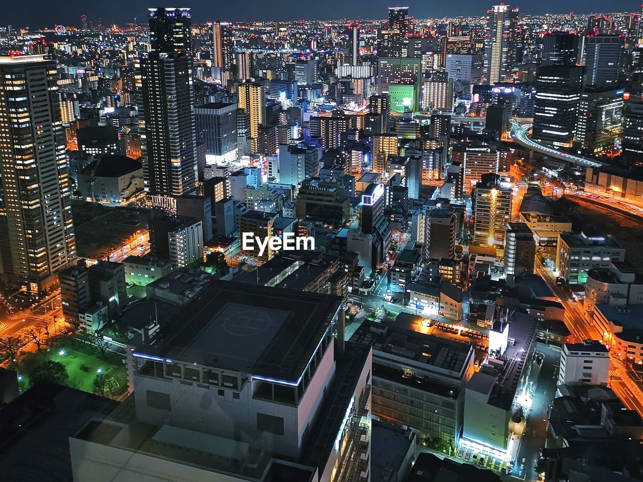 building exterior, city, cityscape, architecture, built structure, illuminated, high angle view, building, office building exterior, night, crowd, crowded, skyscraper, residential district, city life, modern, tall - high, tower, financial district, outdoors, spire