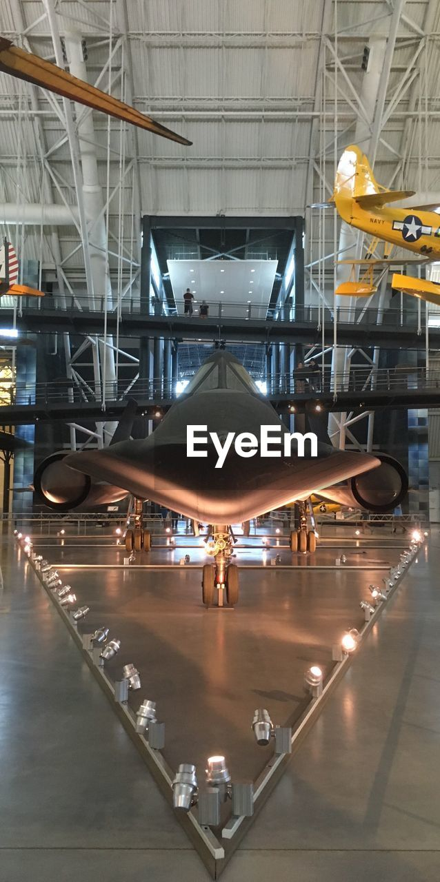 illuminated, airplane, airport, indoors, air vehicle, transportation, factory, industry, built structure, technology, airplane hangar, no people, aerospace industry, architecture, day