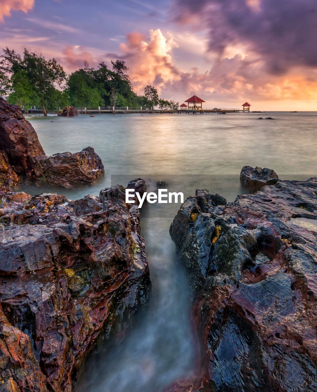 water, sky, sunset, nature, rock - object, beauty in nature, scenics, cloud - sky, outdoors, tranquility, tranquil scene, sea, no people, tree, day