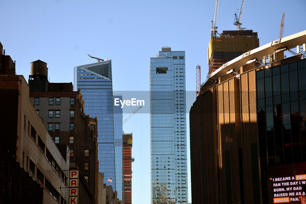 architecture, building exterior, built structure, skyscraper, city, no people, modern, day, clear sky, outdoors, sky