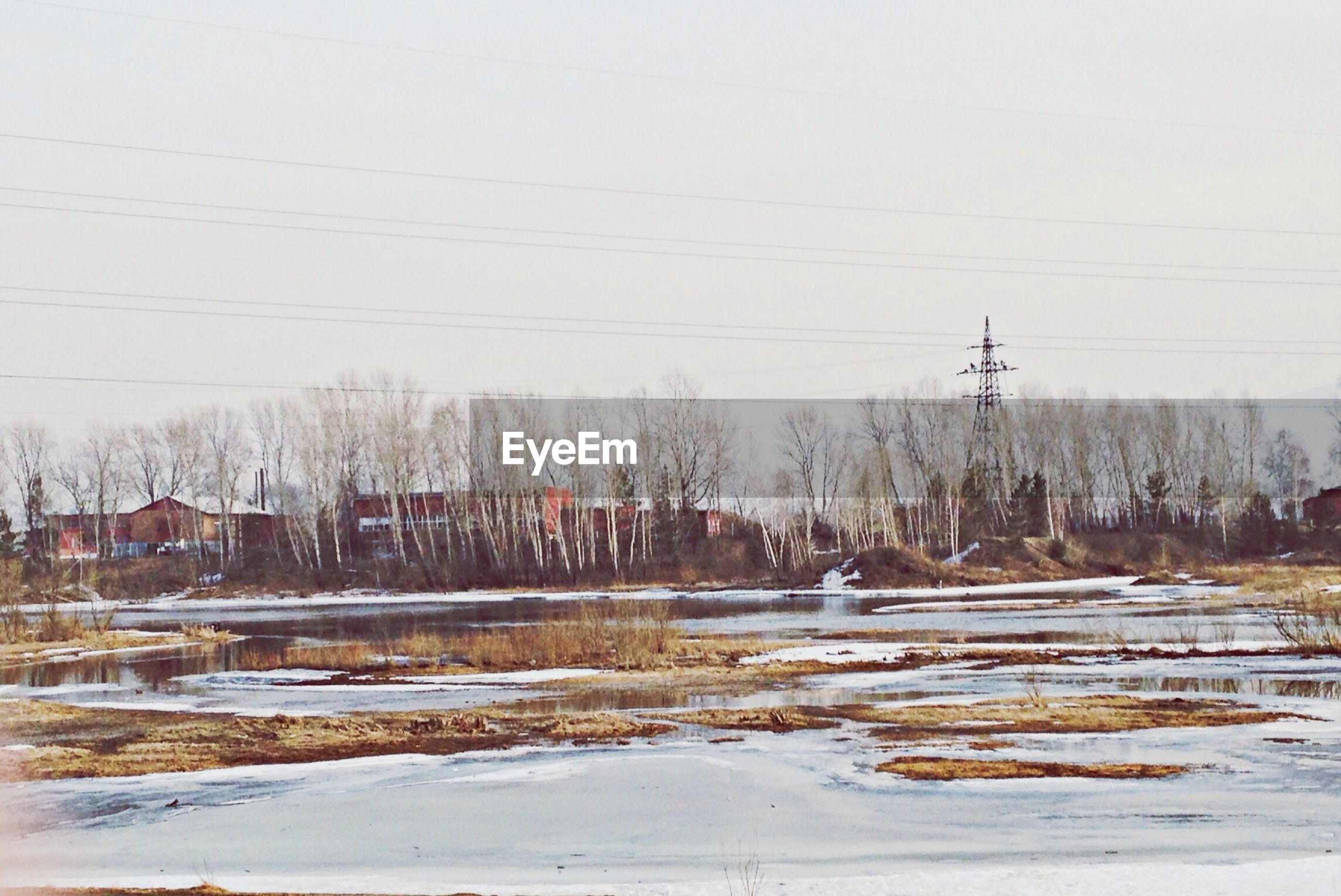 snow, winter, cold temperature, power line, season, electricity pylon, weather, field, fuel and power generation, nature, frozen, landscape, electricity, cable, sky, day, power supply, outdoors, covering, rural scene