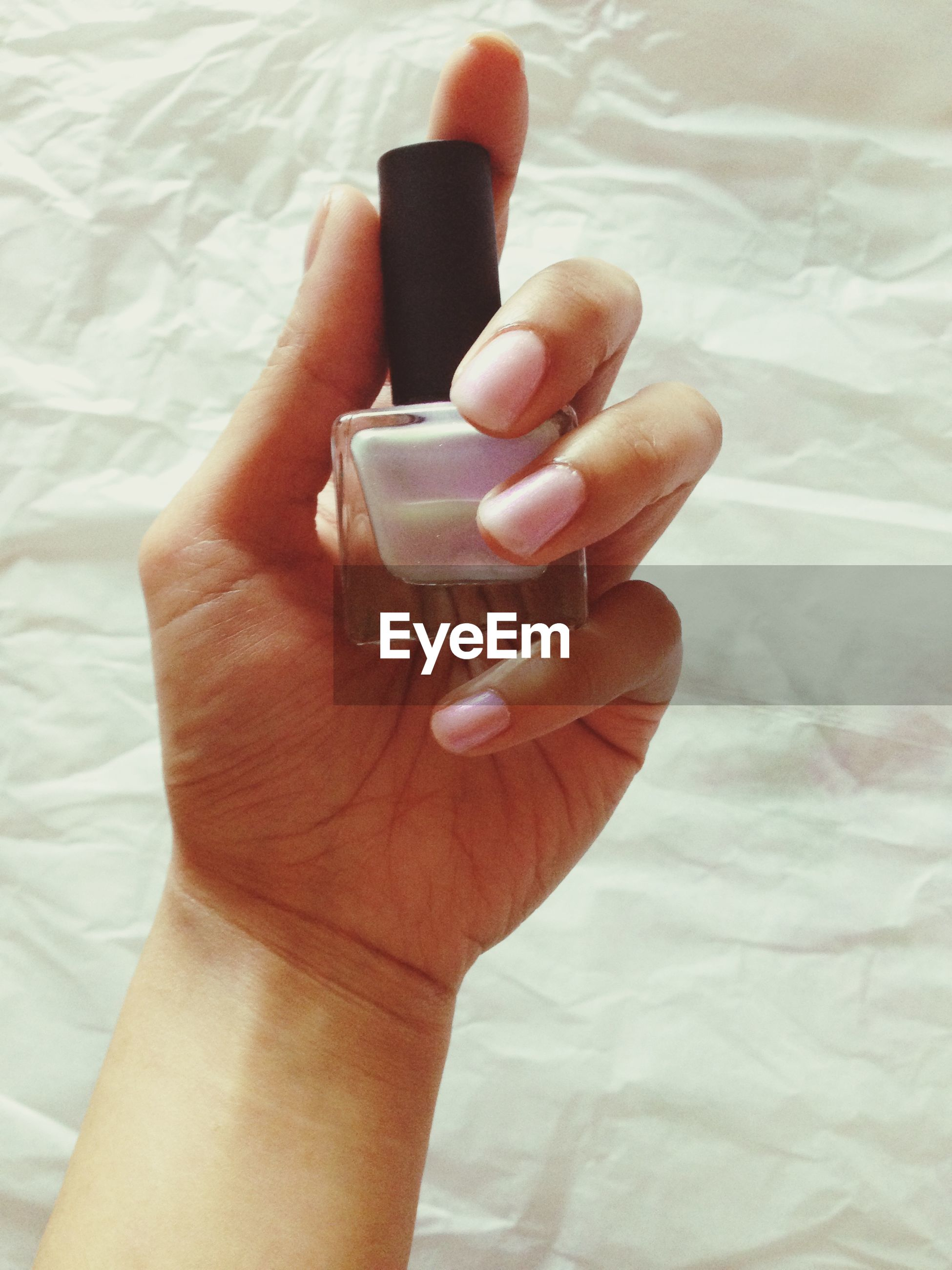person, part of, indoors, holding, cropped, human finger, personal perspective, close-up, unrecognizable person, table, high angle view, ring, lifestyles, food and drink, showing, creativity