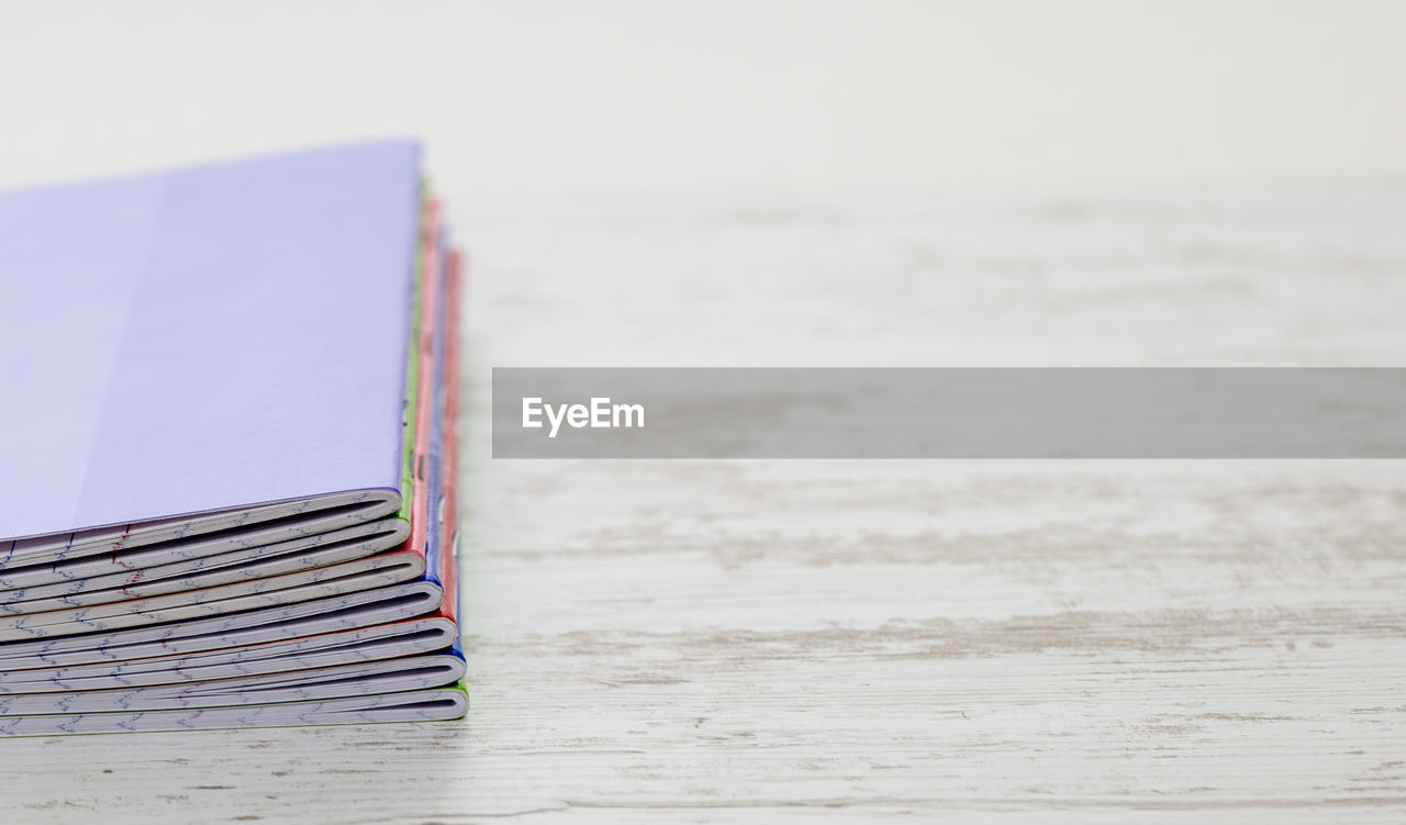 beach, no people, sea, publication, book, still life, education, sand, land, focus on foreground, table, paper, close-up, wood - material, water, literature, absence, day, indoors, hardcover book