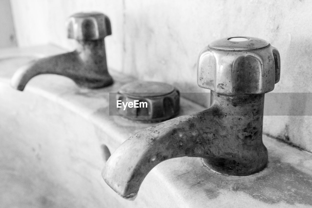 Close-Up Of Old Faucet On Sink
