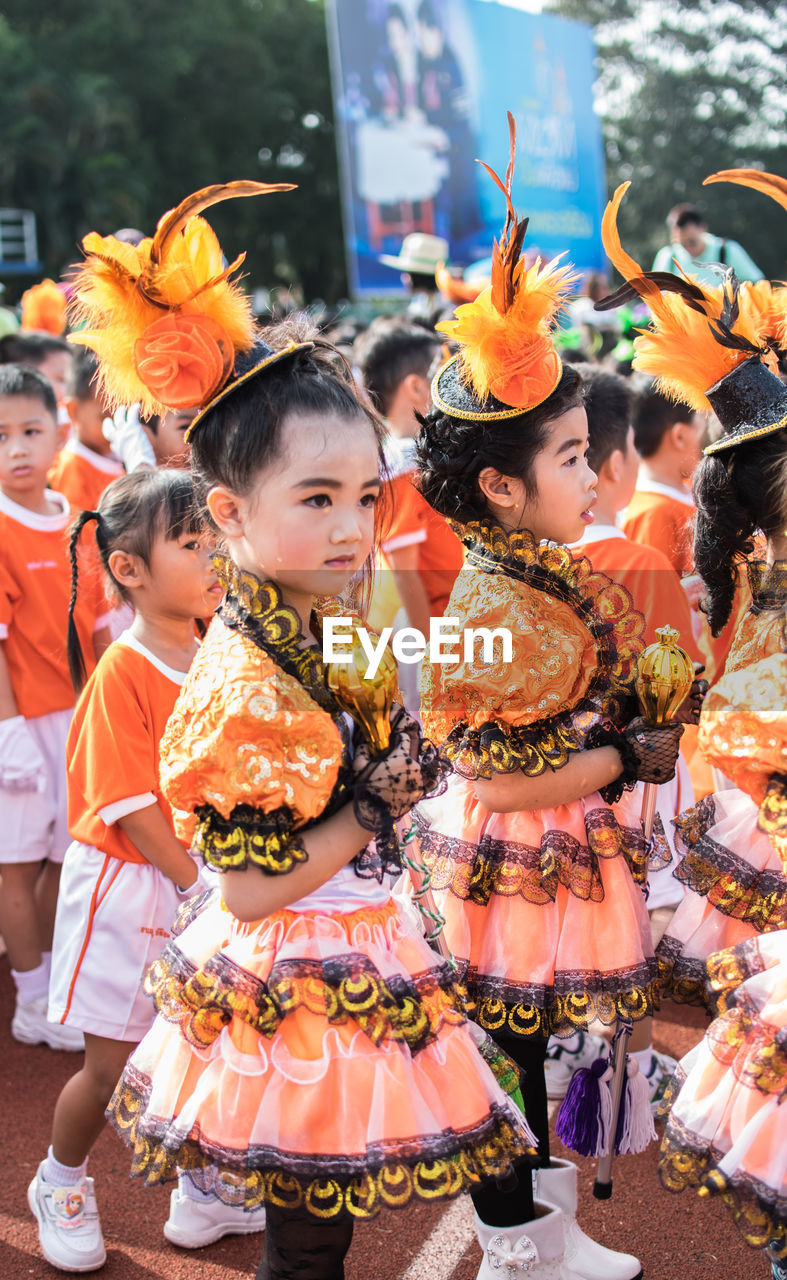 costume, traditional clothing, real people, cultures, tradition, celebration, traditional dancing, event, traditional festival, large group of people, togetherness, girls, lifestyles, halloween, leisure activity, outdoors, childhood, day, performance, standing, headdress