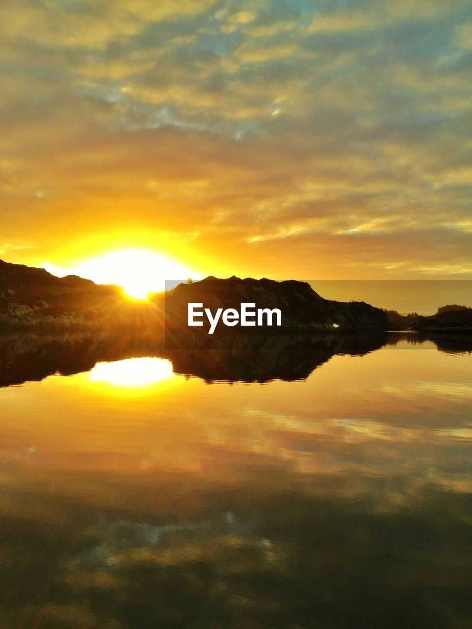 sunset, nature, sky, beauty in nature, orange color, scenics, sun, no people, tranquil scene, tranquility, reflection, water, outdoors, cloud - sky, mountain, yellow, scenery, day