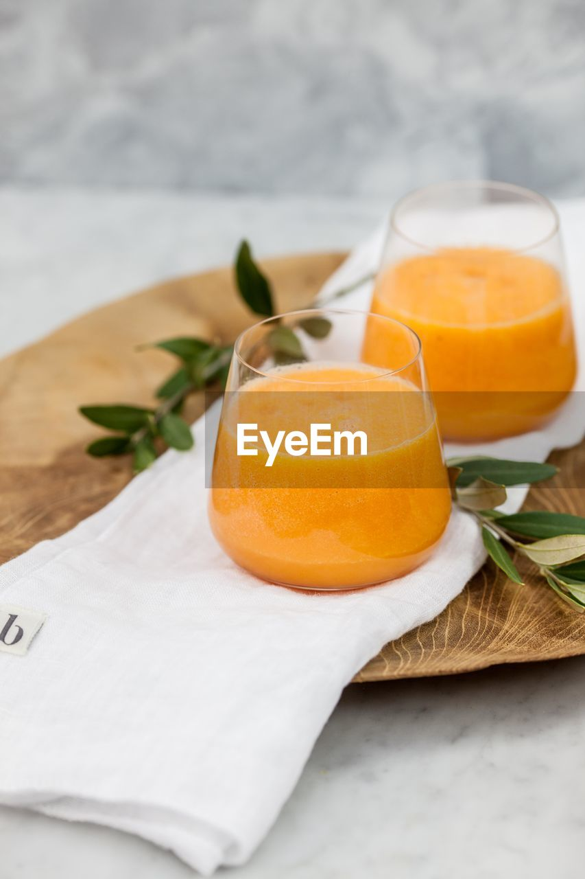 food and drink, freshness, healthy eating, drink, fruit, indoors, drinking glass, table, no people, close-up, orange juice, food, ready-to-eat, day