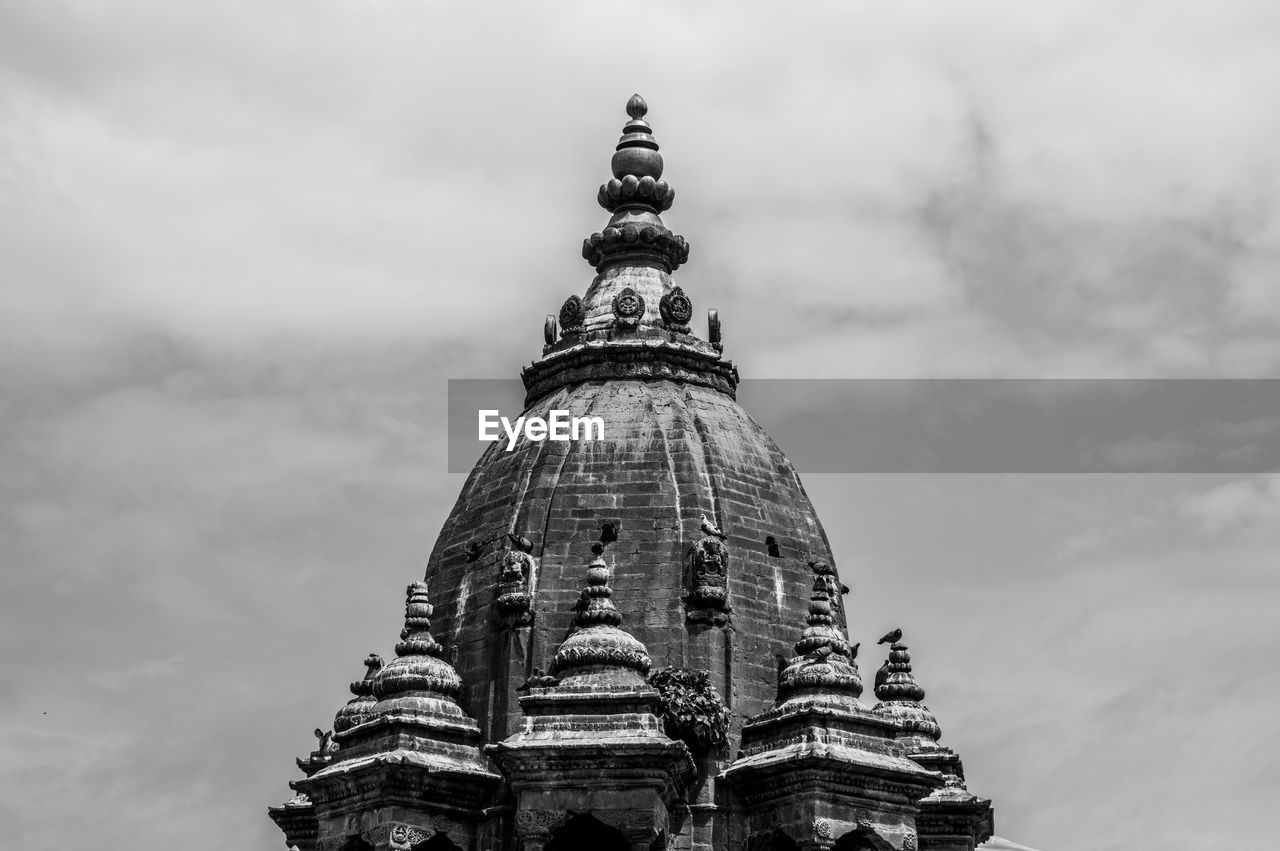 LOW ANGLE VIEW OF A TEMPLE BUILDING