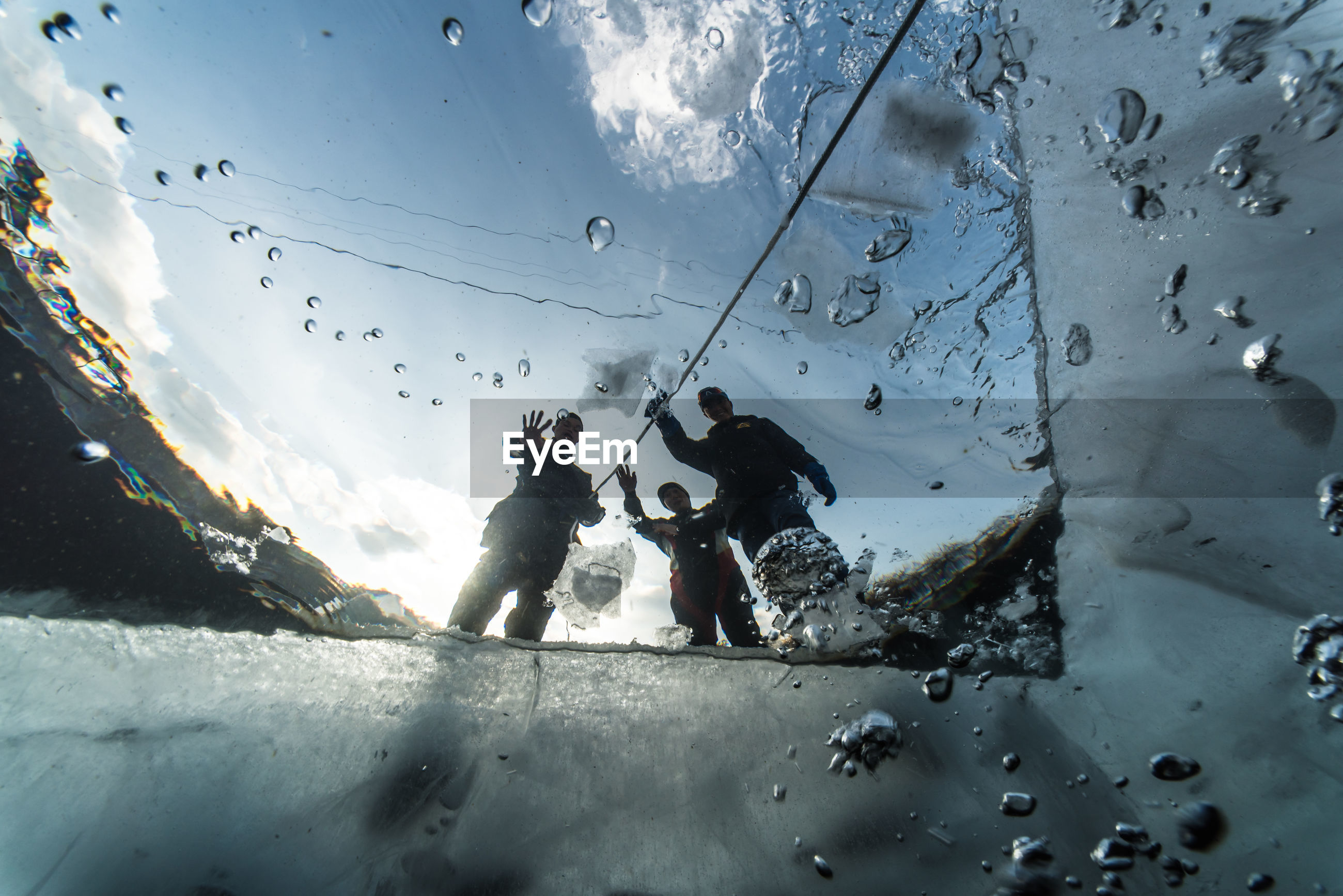 Low angle view of men seen from underwater