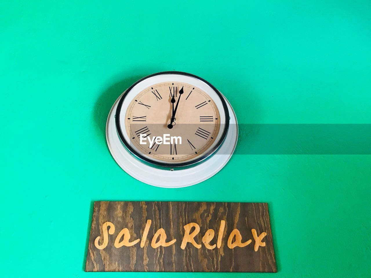 clock, time, text, communication, green color, number, wall - building feature, instrument of time, western script, wall clock, no people, clock face, minute hand, indoors, shape, hour hand, roman numeral, capital letter, low angle view, clock hand