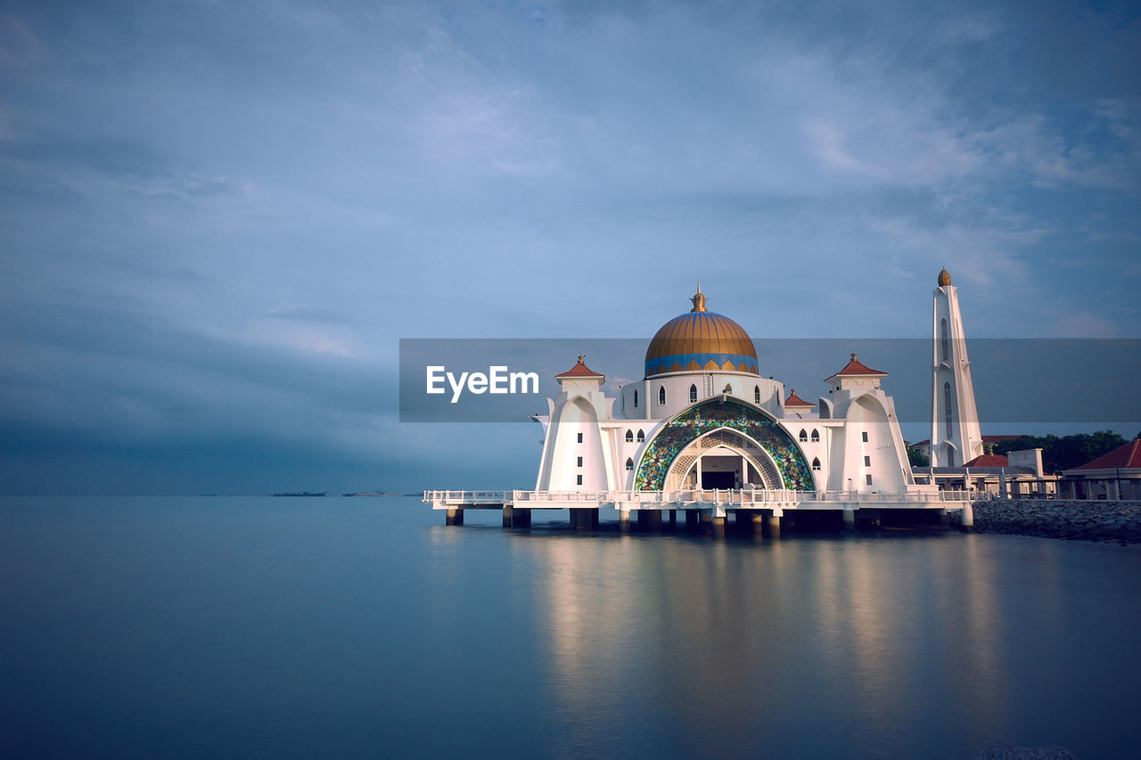 dome, sky, built structure, building exterior, architecture, cloud - sky, water, religion, place of worship, waterfront, belief, building, spirituality, travel destinations, nature, travel, no people, outdoors