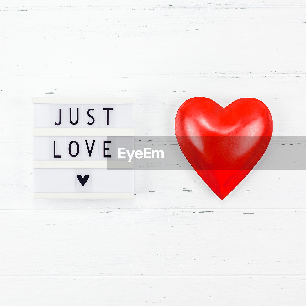 heart shape, positive emotion, love, text, western script, red, emotion, communication, no people, indoors, white color, capital letter, close-up, wall - building feature, shape, design, copy space, still life, message, valentine's day - holiday