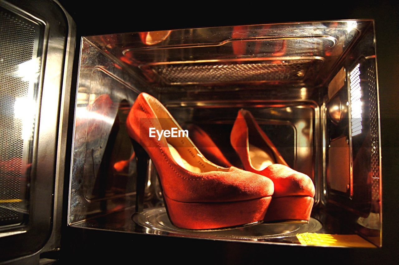 Close-Up Of High Heels In Microwave
