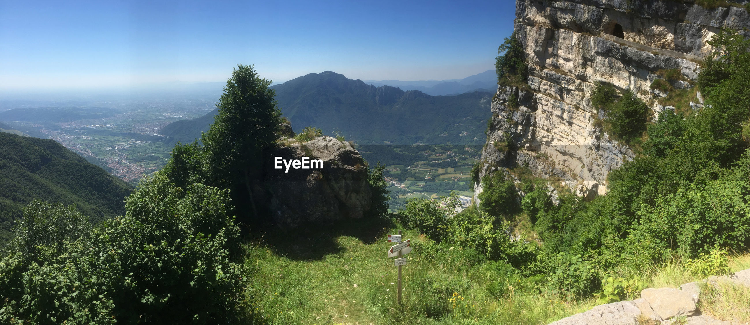 SCENIC VIEW OF MOUNTAINS AND CLEAR SKY