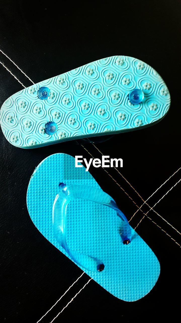 Close-up of blue flip-flops