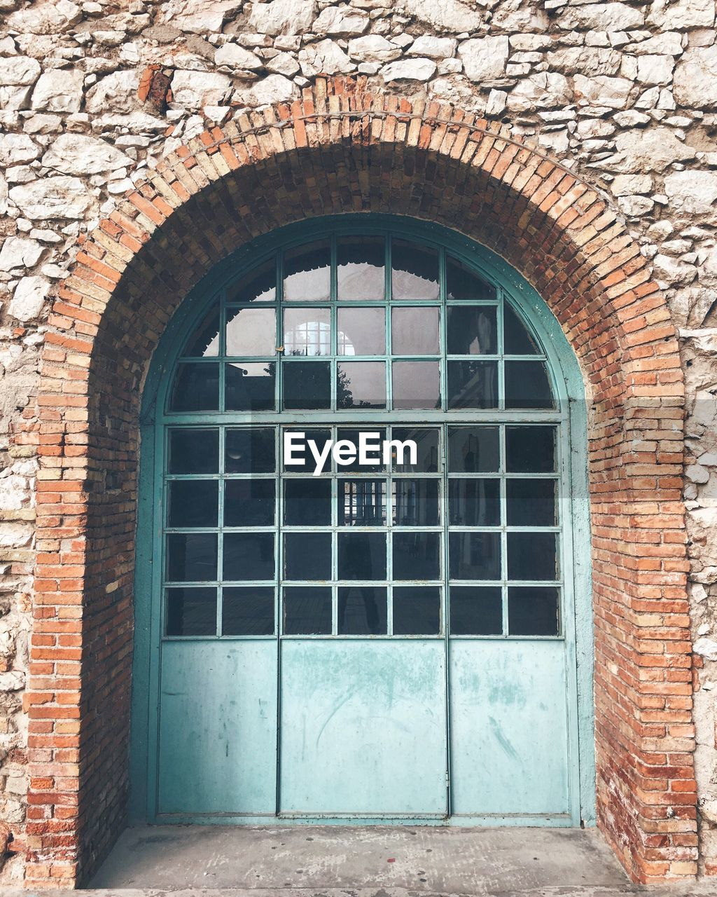 architecture, built structure, window, wall, brick, arch, building, brick wall, building exterior, day, entrance, door, no people, closed, old, outdoors, security, wall - building feature, protection, glass - material, arched