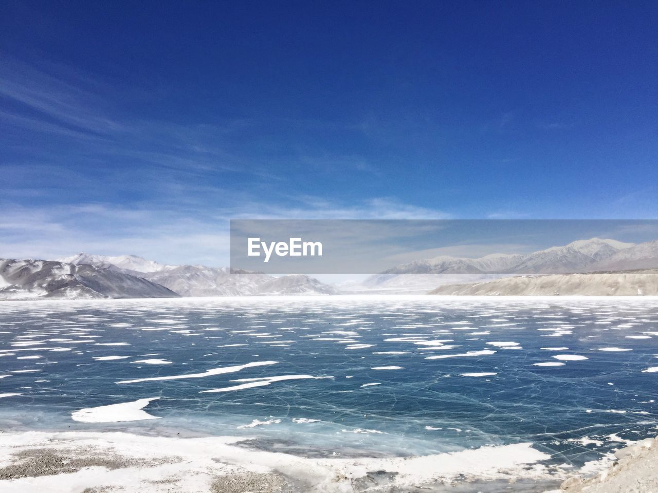 cold temperature, nature, beauty in nature, ice, scenics, tranquility, tranquil scene, mountain, snow, winter, landscape, outdoors, no people, day, frozen, blue, mountain range, sunlight, sky, lake, iceberg, water, salt - mineral