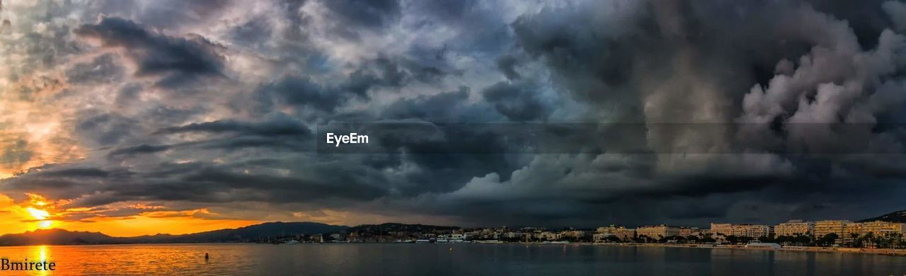cloud - sky, sky, weather, dramatic sky, nature, architecture, water, sunset, scenics, building exterior, storm cloud, beauty in nature, built structure, outdoors, sea, mountain, reflection, no people, waterfront, night, tranquility, thunderstorm, city, illuminated, cityscape, lightning, forked lightning