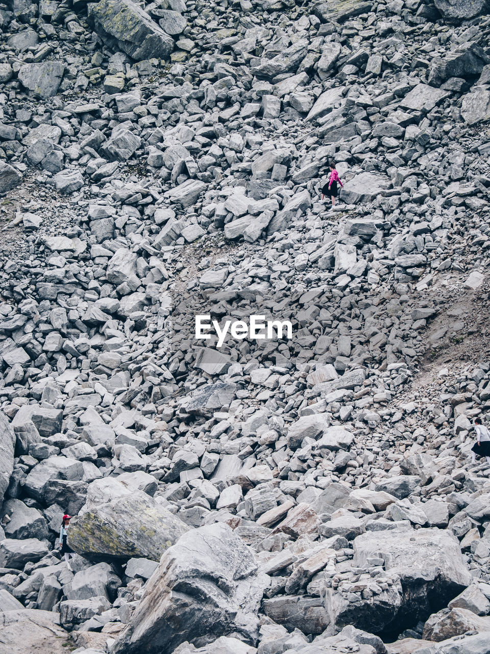 rock - object, high angle view, one person, adventure, day, real people, men, women, only women, outdoors, adult, adults only, people, nature, young adult