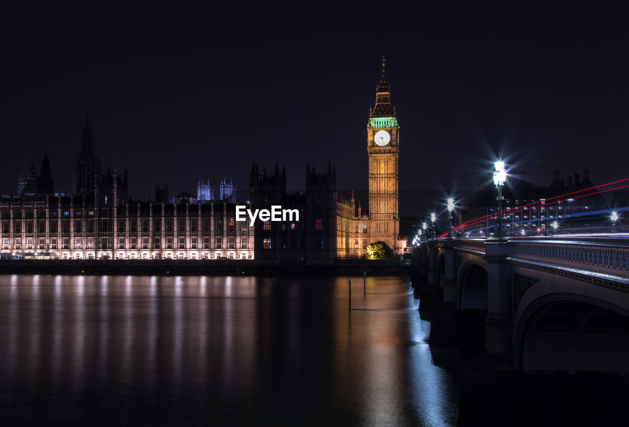 Big ben and houses of parliament against sky at night
