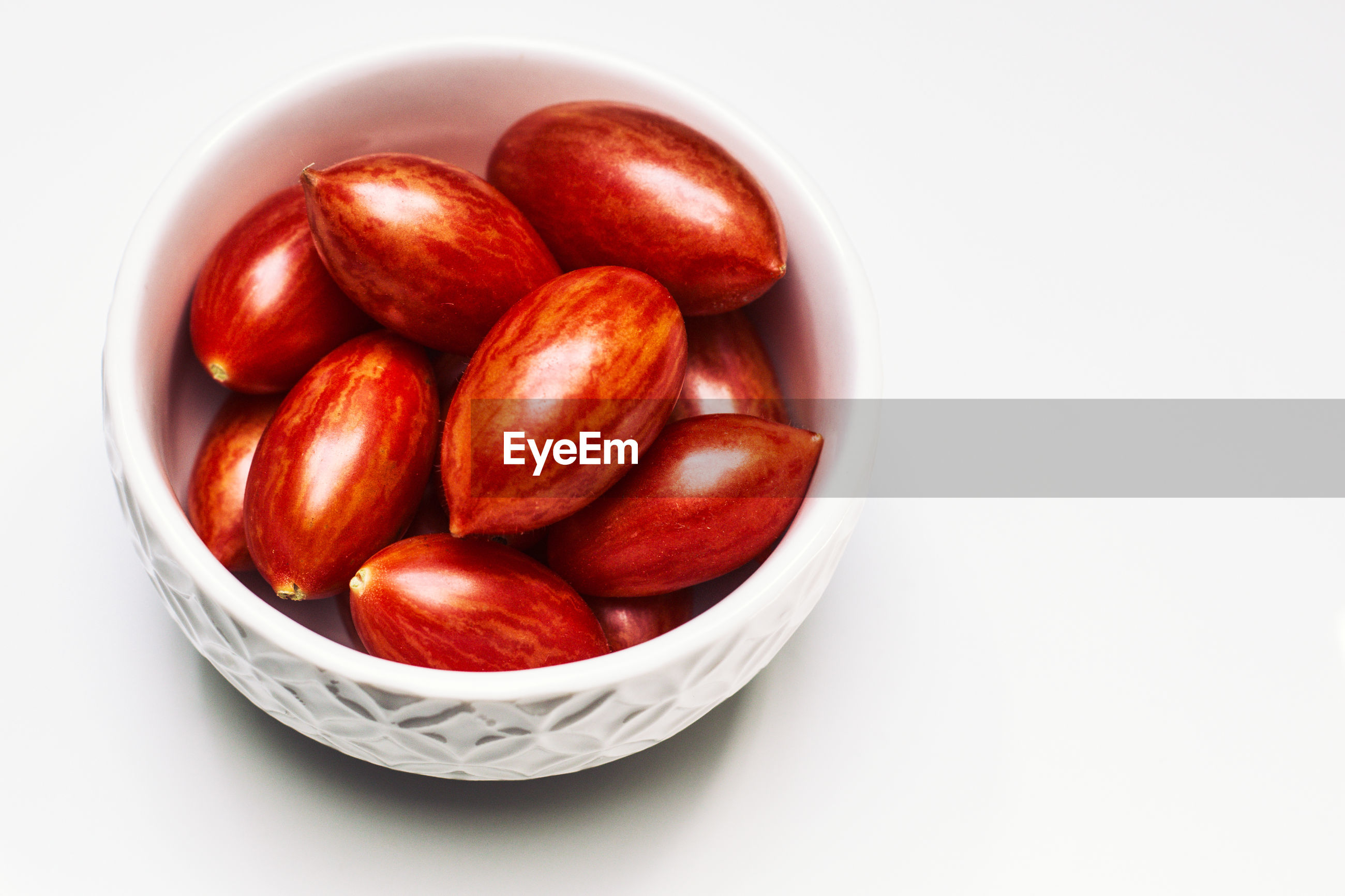 High angle view of nuts in bowl over white background