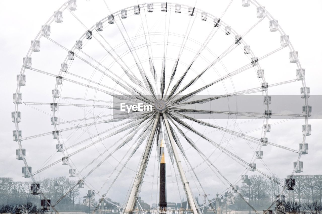 Ferris Wheel Spinning Against Sky