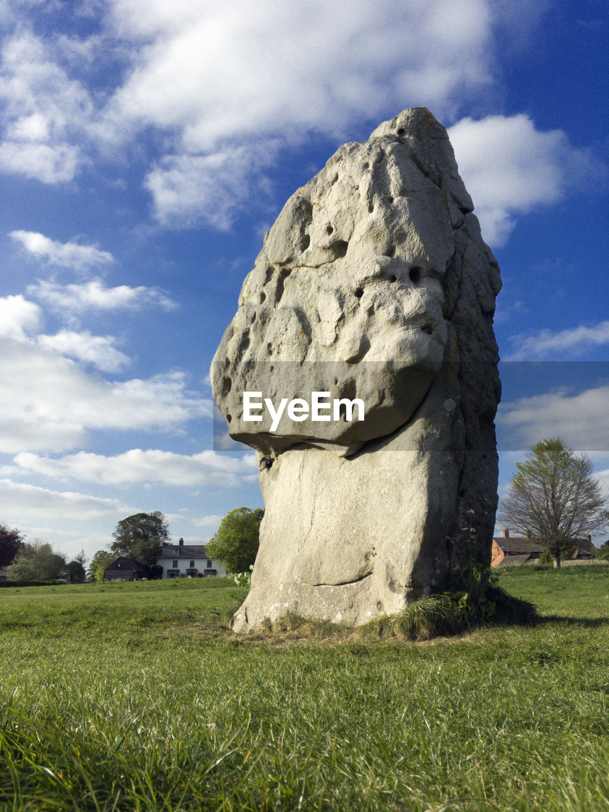 Stack rock on field at avebury against sky