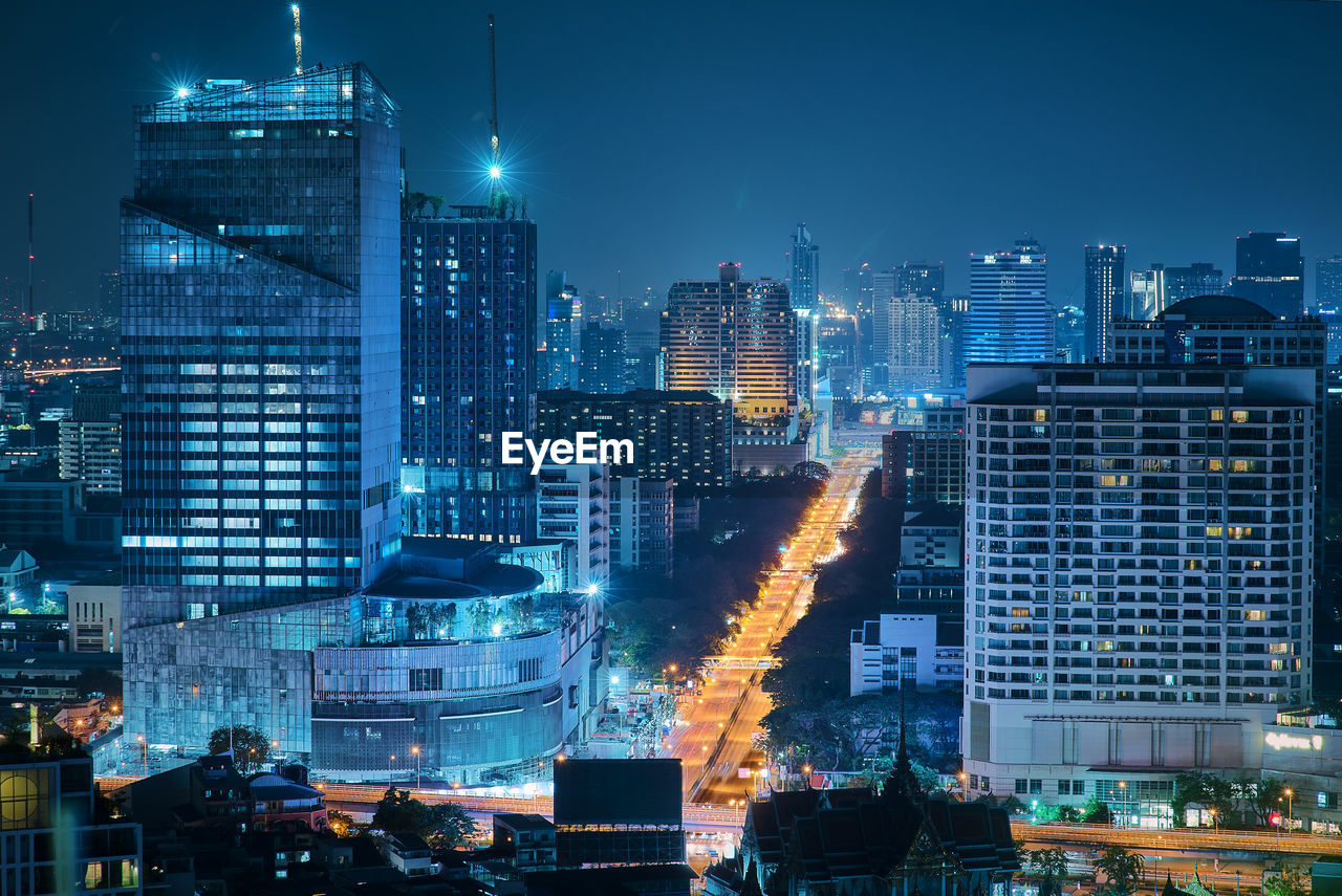 building exterior, built structure, city, architecture, building, illuminated, cityscape, night, office building exterior, modern, tall - high, skyscraper, no people, office, sky, nature, tower, residential district, landscape, outdoors, financial district, spire, settlement