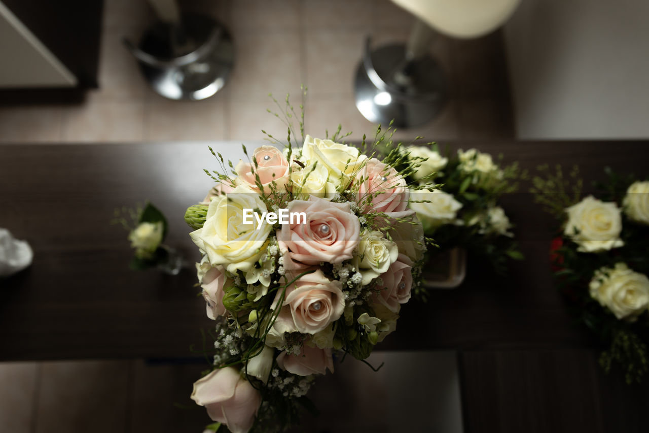 flower, flowering plant, flower arrangement, bouquet, freshness, rose, beauty in nature, plant, rose - flower, arrangement, flower head, indoors, vulnerability, fragility, wedding, close-up, celebration, nature, focus on foreground, event, bunch of flowers, wedding ceremony