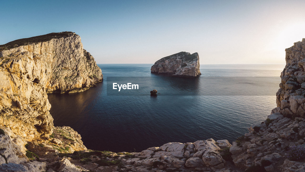 sea, water, rock, sky, rock - object, solid, scenics - nature, beauty in nature, tranquility, tranquil scene, horizon over water, horizon, rock formation, nature, clear sky, land, idyllic, non-urban scene, cliff, no people, outdoors, stack rock