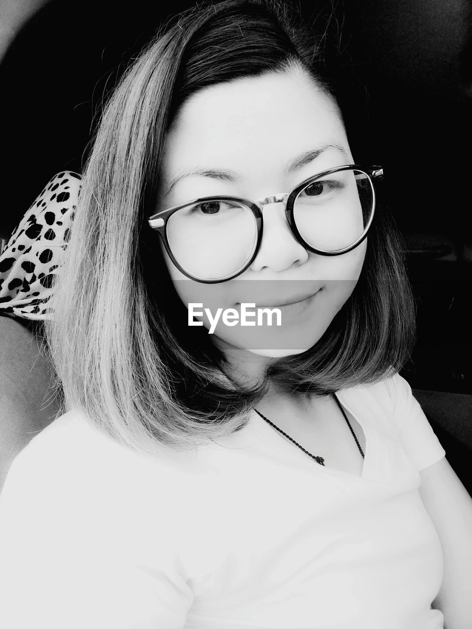 Close-Up Of Beautiful Woman Wearing Eyeglasses