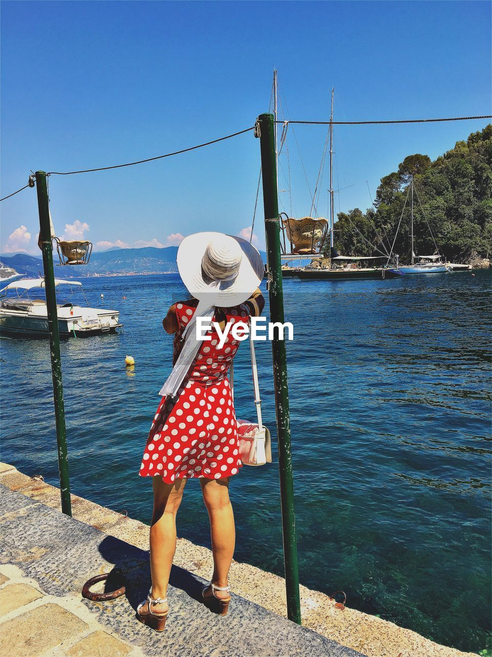 real people, one person, water, day, standing, full length, rear view, leisure activity, casual clothing, outdoors, nautical vessel, lifestyles, nature, sea, women, sky, people