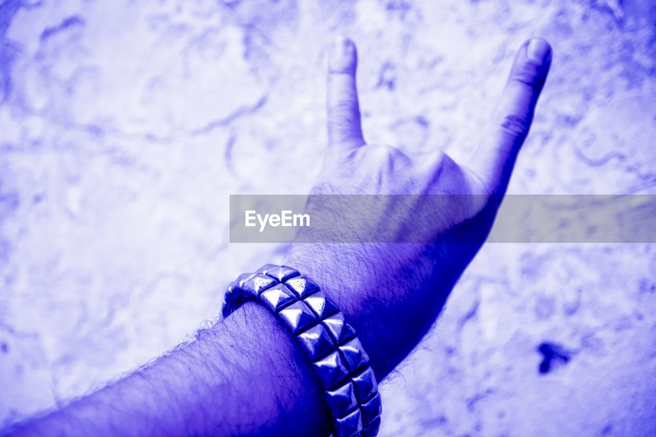 human body part, human hand, hand, real people, one person, personal perspective, body part, close-up, lifestyles, blue, finger, high angle view, human finger, focus on foreground, day, bracelet, leisure activity, men, low section, human limb, human foot
