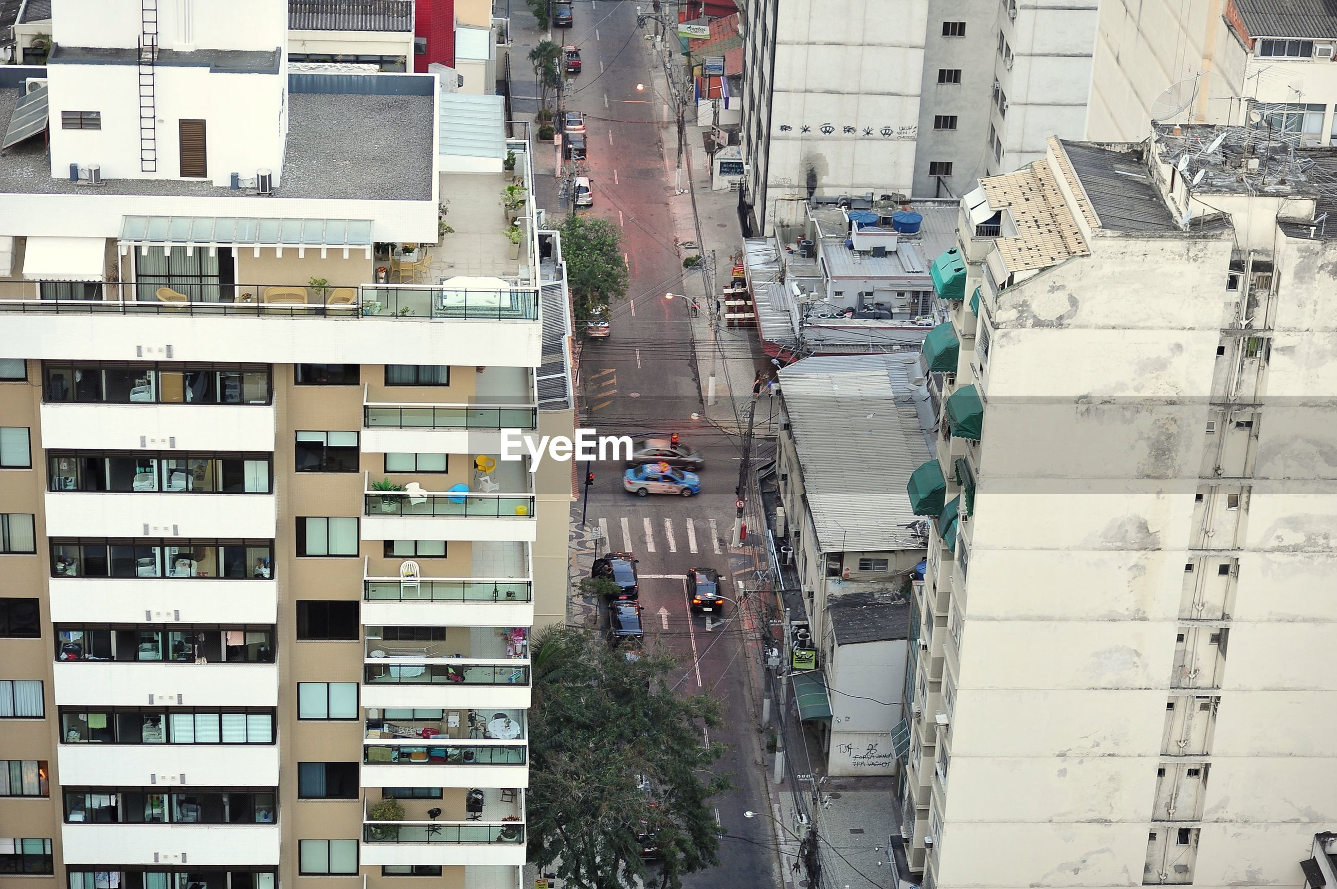 High angle view of cars on road amidst residential buildings