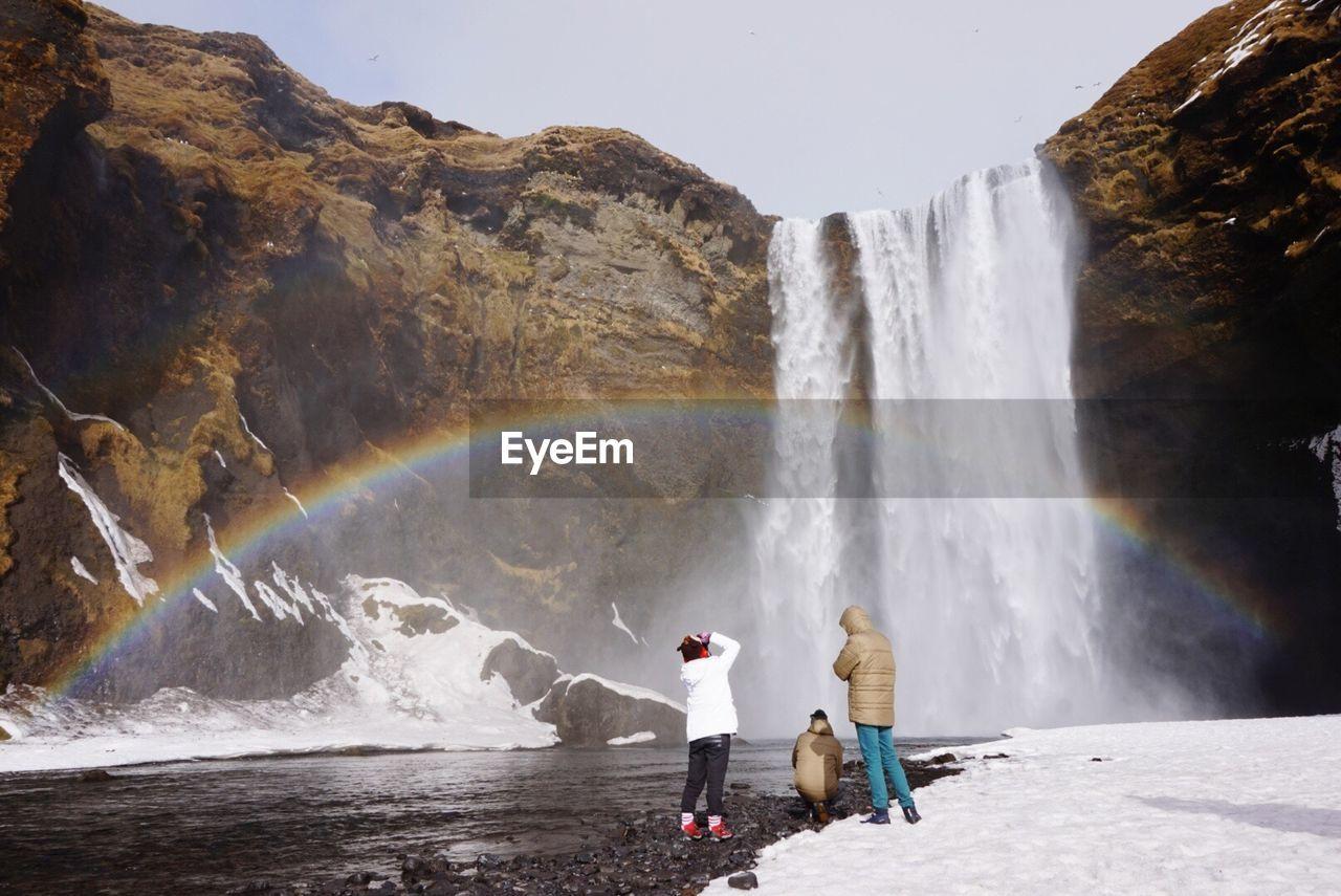 People Enjoying Against Waterfall