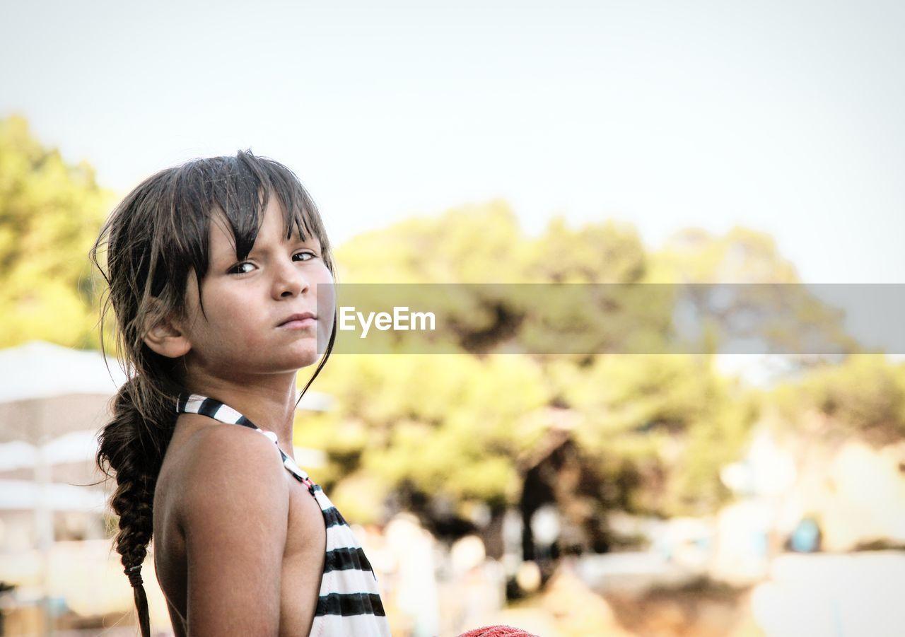 Portrait Of Girl Standing Against Sky