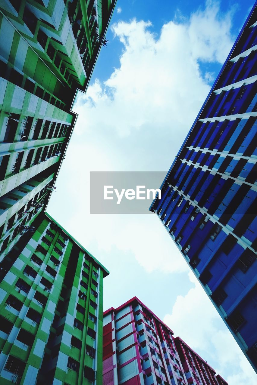 low angle view, architecture, building exterior, built structure, sky, cloud - sky, day, modern, skyscraper, outdoors, no people, city, growth, tall
