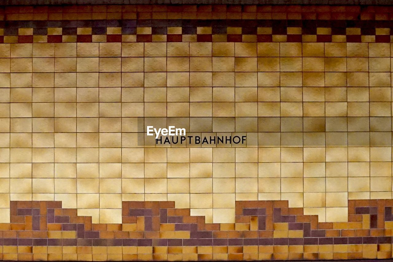 western script, text, capital letter, communication, mosaic, tile, pattern, no people, architecture, indoors, pixelated, day, close-up