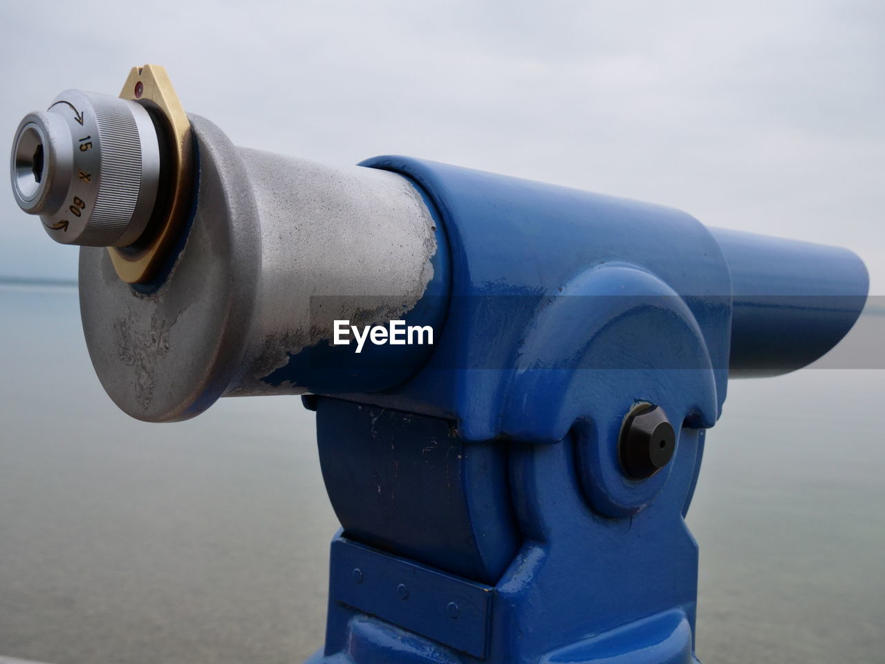 binoculars, water, coin operated, metal, coin-operated binoculars, day, focus on foreground, sea, close-up, no people, nature, sky, security, outdoors, surveillance, blue, beach, technology, land, silver colored, hand-held telescope