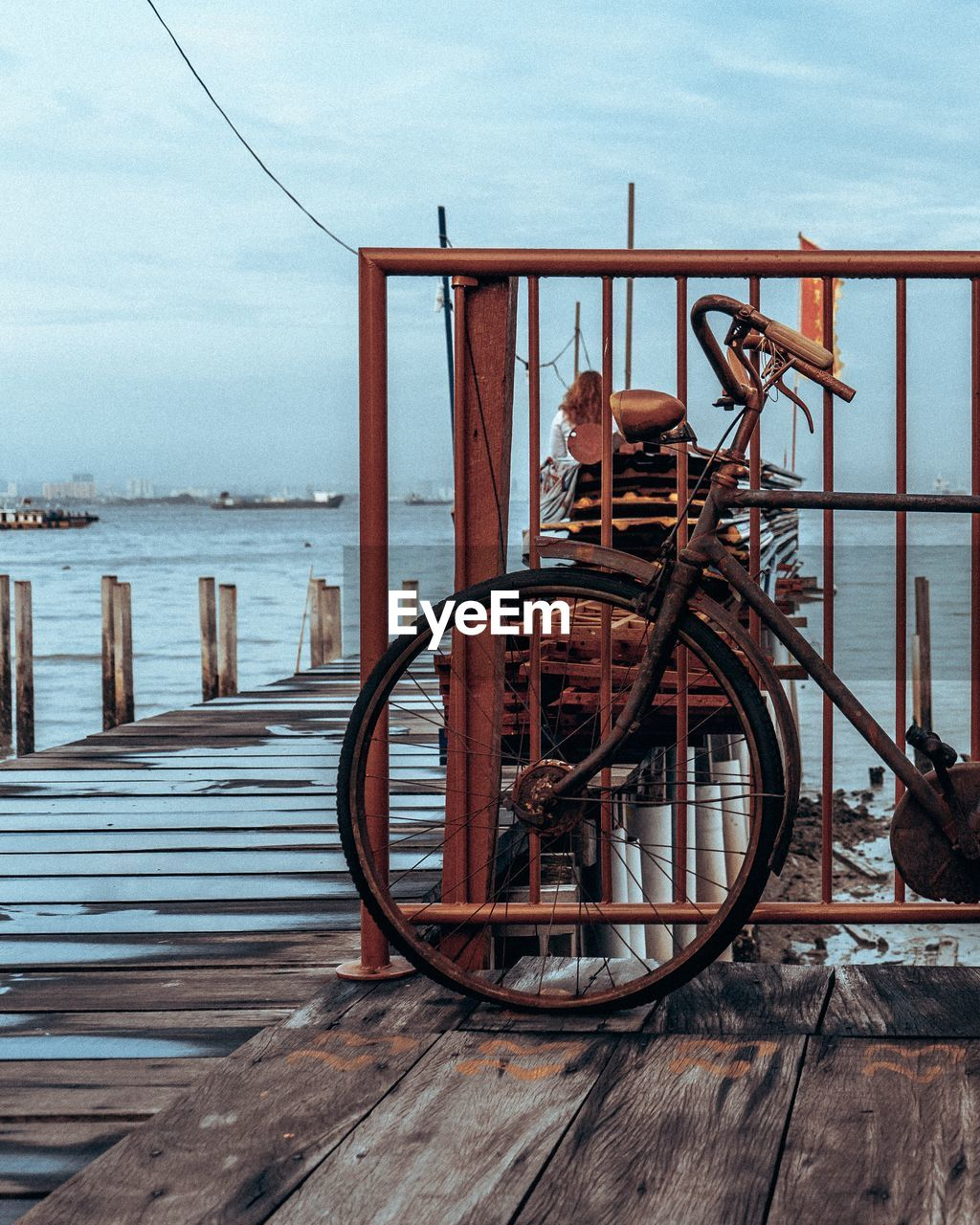 Bicycle By Sea Against Sky